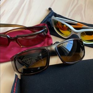 Three pairs of sunglasses, Oakley, Suncloud, Bolle